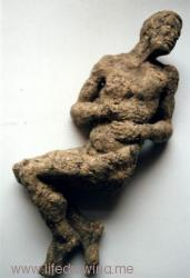 reclining male nude cast in paper pulp