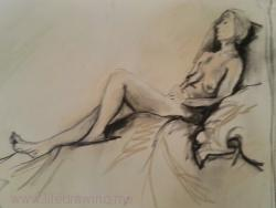 Woman reclining with eyes closed
