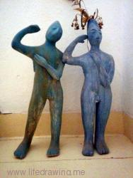 two standing ceramic figures